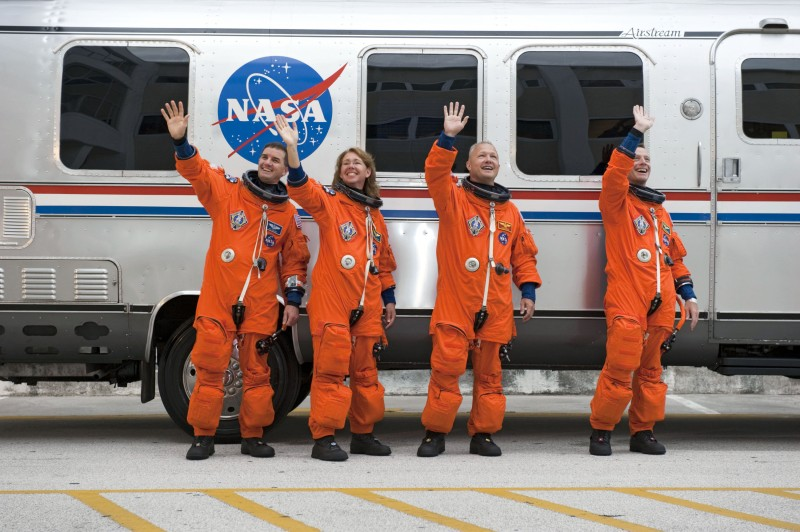STS_135_crew_wave_farewell_before_the_launch.jpg